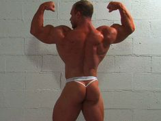 VIDEO: Bodybuilder Con Demetriou poses and flexes his muscles in a mens thong g-string. Click the image to watch the video.