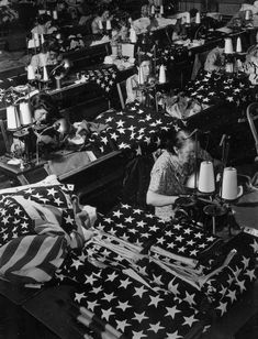 women in a factory sewing the American flag (photo by by Margaret Bourke-White)
