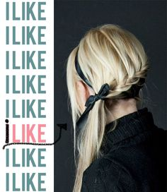 Lace braid (like a french braid but new hair only added from the top) with a ribbon headband.  Love.