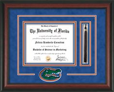 University of Florida Diploma Frame - UF Gators - with hardwood moulding and laser Gator cutout and tassel holder.  Also features blue suede on orange mats and UV glass to protect your investment from fading over time.  And to keep those memories as alive as the day you earned them! Go Gators! tassel, diploma frame