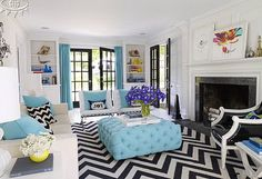 Black, white, and turquoise make a graphic splash in fashion designer Liz Lange's house in Westchester County, New York. Decorator Jonathan Adler designed most of the furnishings and accessories, including the living room's generous ottoman upholstered in Hinson's Montauk Texture in Aegean, the Herringbone rug, and the black patent leather Regent armchair. Knoll Barcelona chairs from Design Within Reach. living rooms, rug, color schemes, blue, colors, black white, hous, live room, chevron