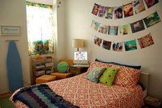 love the photos over the bed cute idea for @Allison Sousan bedroom