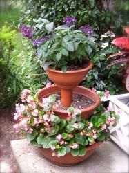 DIY 3-tiered planter!  That's PVC piping in the center!