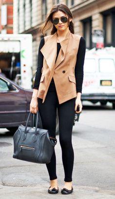 Black leggings, shirt, flats and a sand coat.