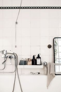 Black and white bath with black tile trim