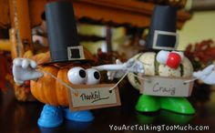 http://youaretalkingtoomuch.com/2012/10/thanksgiving-place-card-holders-for-the-kids-table/