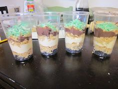 """Digging for dinosaurs snack! Layered graham crackers, oreos,  pudding, etc. with plastic dinosaur """"buried"""" inside. I have to use this idea for Dig Into Reading 2013 Summer Reading Club!"""