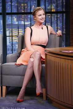 Emily VanCamp gorgeous in peach chiffon dress and orange high heels for her appearance on Late Night With Seth Meyers