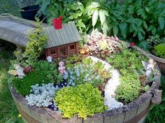How to Create a Fairy Garden in a Container Kate Larsen  made her Fairy garden in a barrel