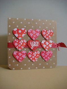 handmade Valentine card ... kraft base ... three rows of punched hearts ... different colors of inks and papers but all in red and white range ... luv it!! ...Hero Arts