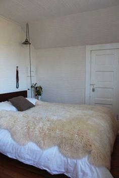Sheepskin on bed