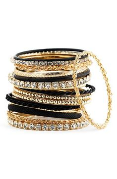 Mixed Media Bangles Set. Black and gold. love that combo.
