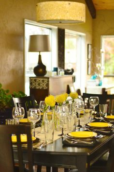 Black and yellow table with Pincushion Protea flowers.