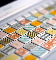 Washi tape adds some fun to drab computer keyboards, with this idea from Her New Leaf. Washi.... washi!