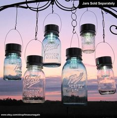 Solar lights are in the lids of these mason jars. What a great idea for a back porch or patio!