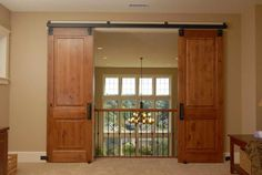 Track Barn Door Hardware With Iron Fence - idea of design for double doors coming from both sides