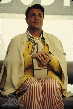Nathan Lane as Plutarch Heavensbee.....LOVE Birdcage movie!