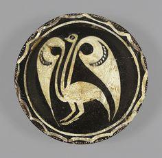 Earthenware slip-painted bowl  Eastern Iran, 4th century AH/10th century CE  14.4 cm diameter; 4.4 cm high