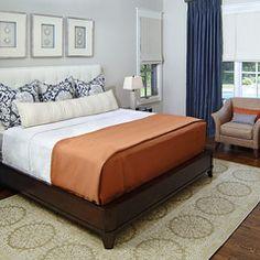 Blue shades + orange + pillows