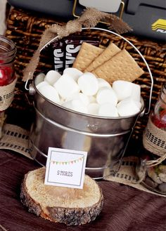 outdoor backyard camping party ideas smores station. I love the cut pieces of wood too. It's so rustic looking.