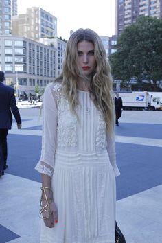 .. White dress, gold cuff ..
