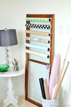 Old door or window becomes a gift wrap holder @cleverlyinspired