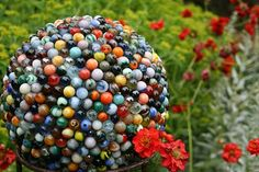 Bowling ball covered in marbles....never lose your marbles again!  LOL  Seriously, though how colorful!  There's one covered in pennies too!  Hmm....may have to go find some old bowling balls this summer!!!