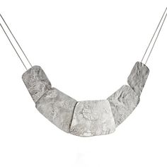 This necklace captures the texture and allure of the moon's surface.