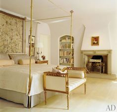 A delicate gilt four-poster bed anchors a Washington, D.C. bedroom