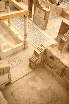 Floor tiles in Ephesus.   Ephesus was one of the 12 cities of the Ionian League during the Classical Greek era. It  later become a major Roman city. It is located on the coast of Ionia near present day Selcuk, Izmir Province, Turkey.