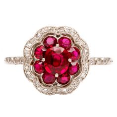 I never find ruby rings i like, but i love this! Antique Ruby Flower Platinum Ring, ca. 1910
