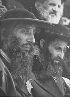 When Lili Jacobs accidently discovered the Auschwitz Album at the close of WWII, the very first person she saw when she looked inside was Rabbi Naftali Zvi Weiss, the chief rabbi of Bilke, her Rabbi from her home town. He is the man on the left in this painting.