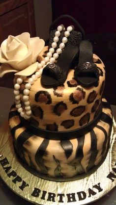 Animal Print on fondant cake with fondant shoes, purse and pearls and flower.