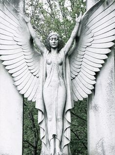 angel sculpture gate (via TheMagicFarawaytTree.tumblr 29623545174)