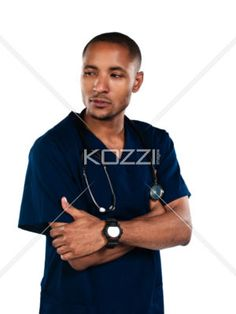 arms folded - Shot of a nurse folding his arms isolated on white. Model: Kareem Duhaney