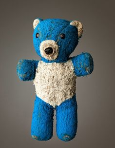 """Much Loved, by Mark Nixon  Hardcover book featuring 65 color portraits of """"loved to bits"""" teddies with the owners memory and stories."""