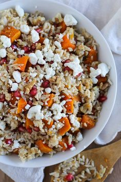 In celebration of side dishes, we present this deliciousness: brown rice with butternut squash, goat cheese, and pomegranate.