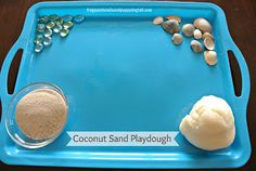 coconut sand play dough recipe and play ideas. What items do you like to add your child's play dough play?