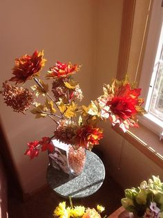 roses made of fall satin leaves and put on real branches