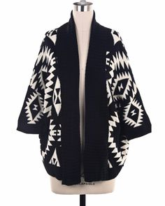 A cardigan featuring shawl collar with aztec print and short sleeves. Open   style. Loose fit.    100% Poly