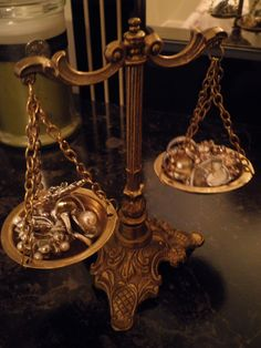 decorative, antique scales of justice used to display pretty rings and earrings