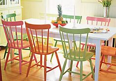 Colorful painted dining chairs.
