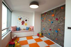 A climbing wall in the playroom with cushion mats below would be excellent in winter months. kid playroom, cushion mat, floor
