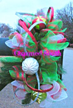 Deco Mesh Christmas Mailbox Topper accented with ornaments.  Follow us on www.facebook.com/charmedsouth