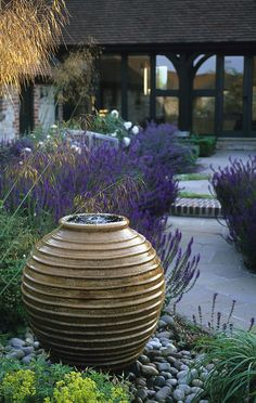 front gardens, garden water fountains, outdoor patio fountains, purple flowers, hous