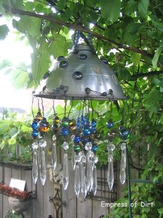 A Garden Chandelier - BLING!  I may adapt this to use my old rhinestones, too. Love it!