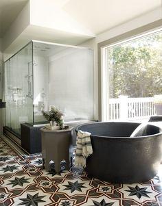 black bathtub heaven. with turkish hammam towel.