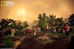 After intense communication with the spirits, participants emerge from a steaming inipi, or purification (sweat) lodge. This ceremony was held by Rick Two Dogs, a medicine man descended from American Horse    Read more: http://www.dailymail.co.uk/news/article-2182898/In-shadow-Wounded-Knee-Inside-Pine-Ridge-reservation-South-Dakota.html#ixzz22Ug3MsNC