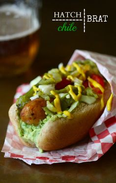 Chicken Andouille Brats with Hatch Chiles and Avocado Crema