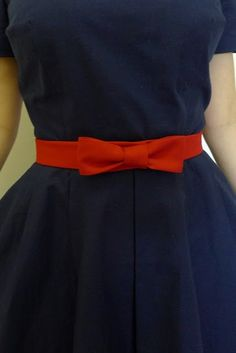 Blue dress.  Red bow tie belt.